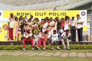 Cricketers are the main attraction at the launch of a polio vaccination round in November Tom Moran / WHO