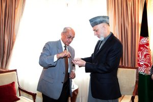Rotary International President Kalyan Banerjee presenting the medal to Afghan President Hamid Karzai Rotary International