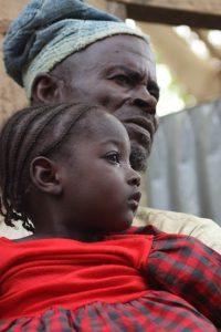 Aisha with her grandfather Muhammad Bello UNICEF/ Andriamasinoro