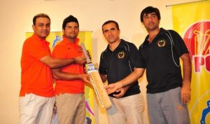 India and Afghanistan team members swapping signed bats to support the eradication of polio from the region. UNICEF