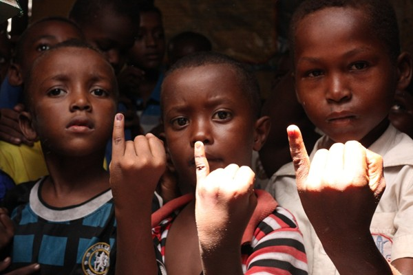 Children in Somalia show their ink stained fingers that show they have received a dose of the oral polio vaccine.
