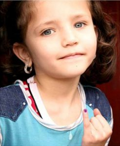 Girl proudly displaying her marked finger, indicating that she has been vaccinated against polio. © Unicef