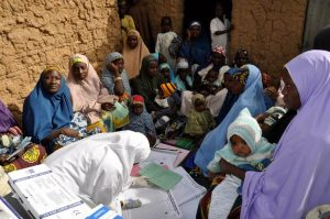 Mothers gather at a health camp in northern Nigeria to get vaccines against polio and other diseases for their children. WHO/L.Dore