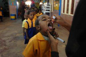 Children line up for oral polio vaccine at a school in Sudan. Johann Hattingh/UNMIS