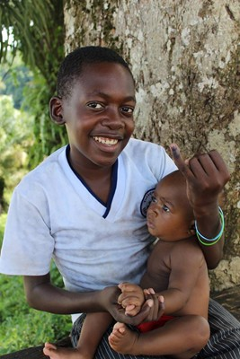 Children in Equatorial Guinea proudly show the dot of ink on their finger that demonstrates they have received a dose of oral polio vaccine.