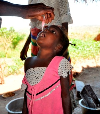 A girl receiving oral polio vaccine.