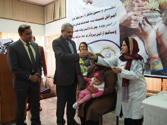Mosaver is the first child in Afghanistan to receive the new Inactivated Polio Vaccine at an event attended by Minister of Public Health Dr Ferozuddin Feroz.