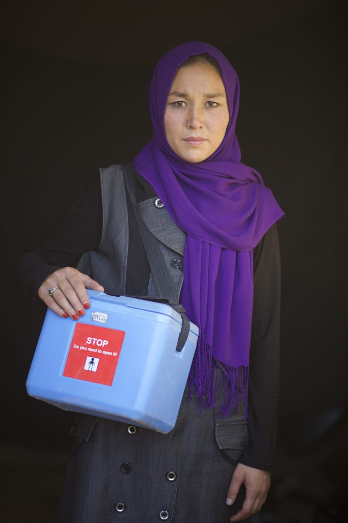 Tahera, 24, who works with the polio campaign as a polio volunteer vaccinator poses for a portrait during the first day of a vaccination campaign in Bamyan on October 17, 2016.