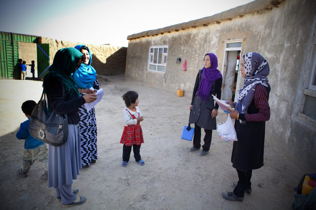 Tahera and her team visit a household in Zargaran, Bamyan, to vaccinate children. Photo: WHO/R.Akbar
