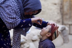A child is given two drops of oral polio vaccine on a vaccination campaign in Afghanistan. © WHO Afghanistan/R. Akbar.