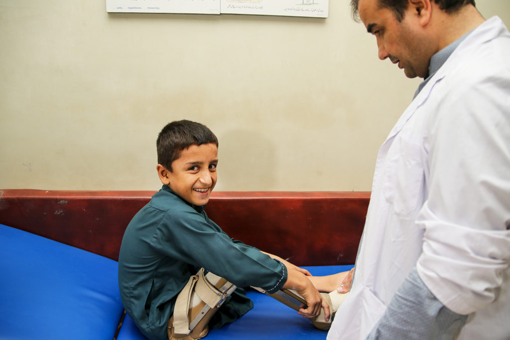 Adil Khan is getting his orthotic device replaced at PIPOS, Peshawar.
