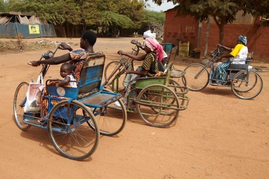 The tricycles are hand-crank operated by the individual to navigate the difficult roads of Burkina Faso. A wider version is also available for adults riding with children and the chairs can be tailor-made in a variety of colours. ©Rotary