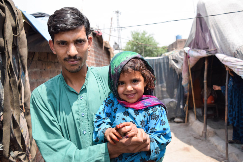 A father posing with his daughter after getting her vaccinated in Lahore, Pakistan. May 2017. ©WHO EMRO / Anam Khan