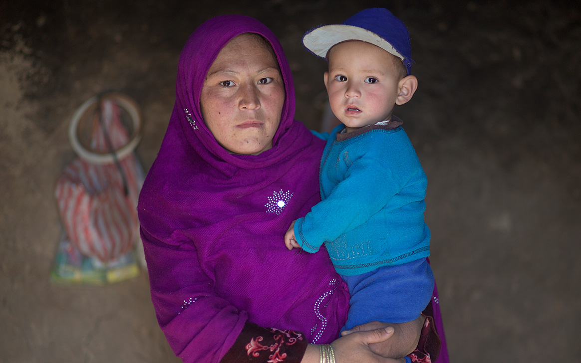 Roqia holds her young son, who was reported through the local surveillance network in Bamyan, Afghanistan, as having acute flaccid paralysis. ©WHO Afghanistan