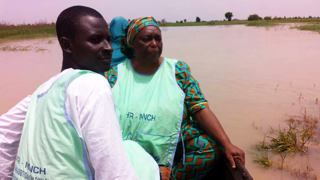 Salamatu Kabir (right), a HTR team lead, travels with other health workers to vaccinate children across two local government districts. © UNICEF Nigeria