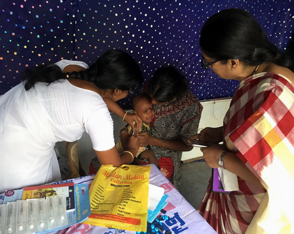 A child is vaccinated with fIPV during a campaign in Hyderabad, India. © WHO/Harish Verma