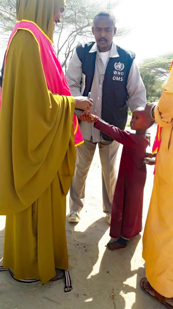 A nomad child is vaccinated against polio in Lower Juba, Somalia.