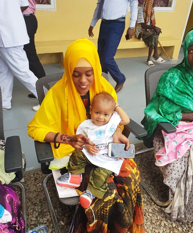 A mother and her child at the launch of the Djibouti NID. WHO/Djibouti