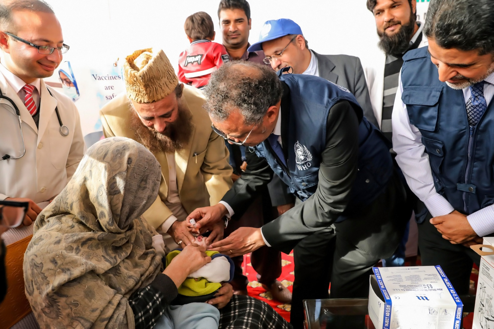 Dr Tedros Adhanom Ghebreysus, WHO Director General and Chair Polio Oversight Board, administering polio drops to a young child in Pakistan. WHO/Jinni