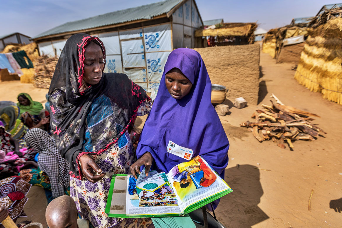 Fatima Umar, a volunteer, is educating Hadiza Zanna about health topics such as hygiene and maternal health, in addition to why polio vaccination is so important. ©Rotary International