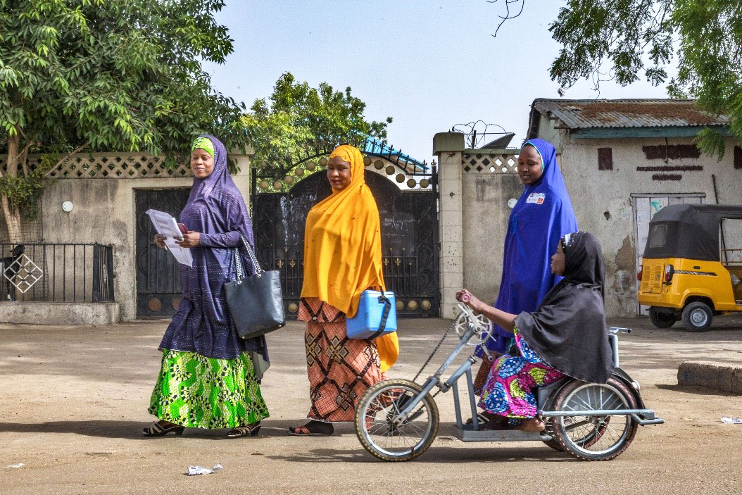 Falmata Mustapha uses her hand-operated tricycle for door-to-door campaigns. ©Rotary International