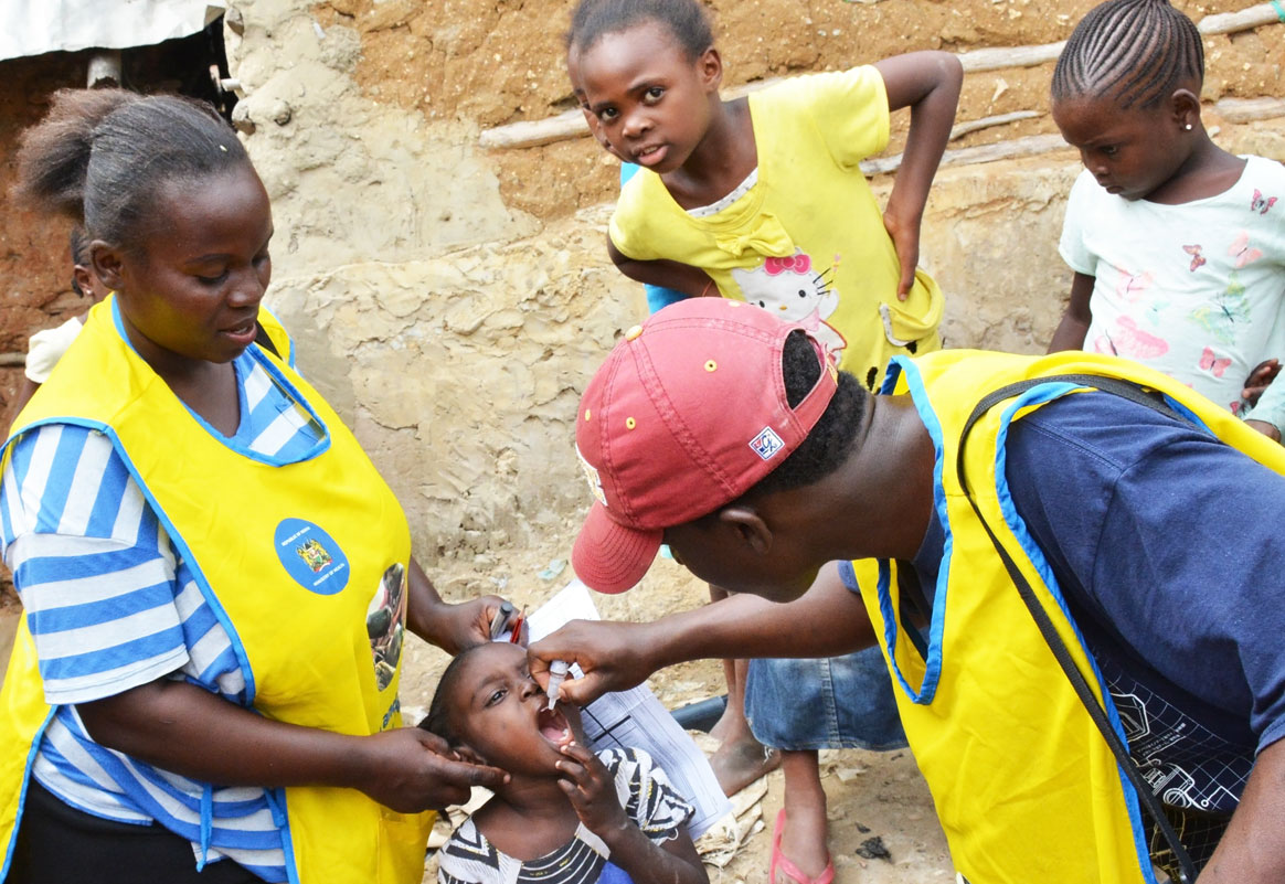 A vaccine is administered to a child during a polio immunization campaign. ©WHO/AFRO